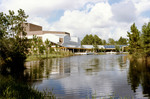 View of the Student Life Center, Building 14 from Osprey Village, 1985. In foreground: Candy Cane Lake.On left: Building 14A,  UNF Theater. Student Life Center and Theater were later named after Andrew A. Robinson Jr.