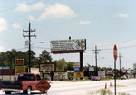 billboard promoting local colleges, Atlantic Blvd June 1984
