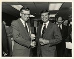 William Flaherty and Governor Graham shake hands