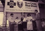Blue Cross and Blue Shield employees deliver canned goods