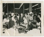 Reporters talk with Alton Yates and Rodney Hurst during the first sit-in demonstration, August 13, 1960.