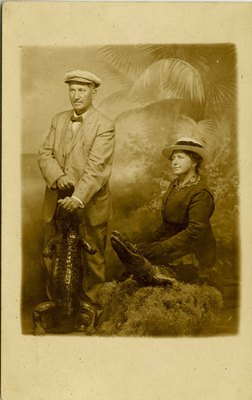 Postcard: Portrait of Couple with Taxidermied Alligators