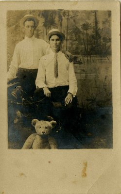 Postcard: Portrait of two men with stuffed Teddy Bear, Jacksonville, Florida; 1900's