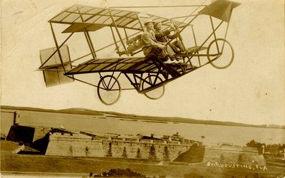 Postcard: Airplane over the Castillio de San Marcos (Fort Marion), St. Augustine, Florida
