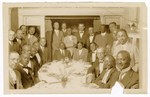 Photograph: Group Portrait, Men Around Tables by R. Lee Thomas