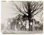 Photograph: Group Portrait, Unidentified People Standing Outside by R. Lee Thomas
