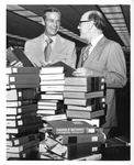 President Carpenter Reviewing Library Books